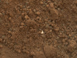 "This image shows part of the small pit or bite created when NASA's Mars rover Curiosity collected its second scoop of Martian soil at a sandy patch called ""Rocknest."""