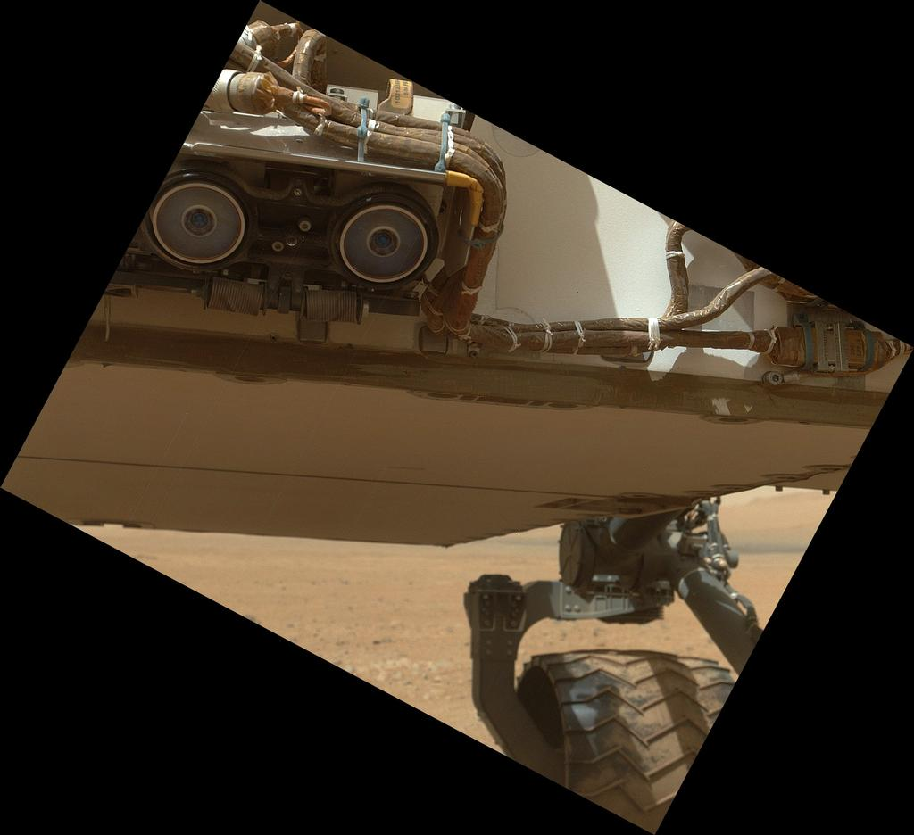 This view of the lower front and underbelly areas of NASA's Mars rover Curiosity was taken by the rover's Mars Hand Lens Imager (MAHLI) during the 34th Martian day, or sol, of Curiosity's work on Mars (Sept. 9, 2012).