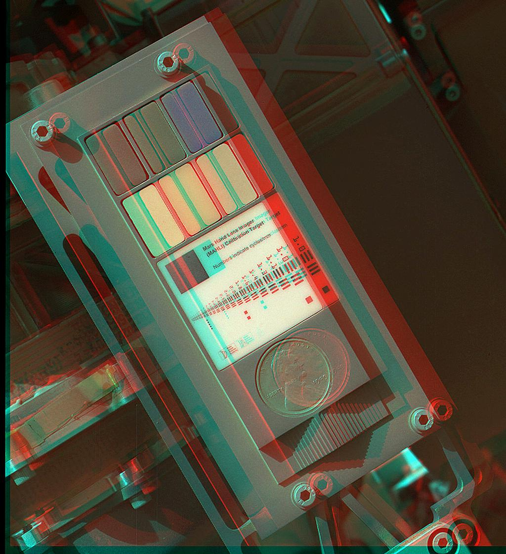 This 3D view of the calibration target for the Mars Hand Lens Imager (MAHLI) aboard NASA's Mars rover Curiosity was assembled from two images taken by that camera during the 34th Martian day, or sol, of Curiosity's work on Mars (Sept. 9, 2012).