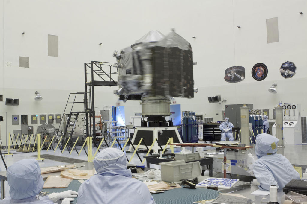 Inside the Payload Hazardous Servicing Facility at NASA's Kennedy Space Center in Florida, engineers and technicians perform a spin test of the Mars Atmosphere and Volatile Evolution, or MAVEN, spacecraft.