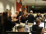 This image shows about 20 people wearing black shirts and mic headset clapping to celebrate MAVEN's arrival at Mars.
