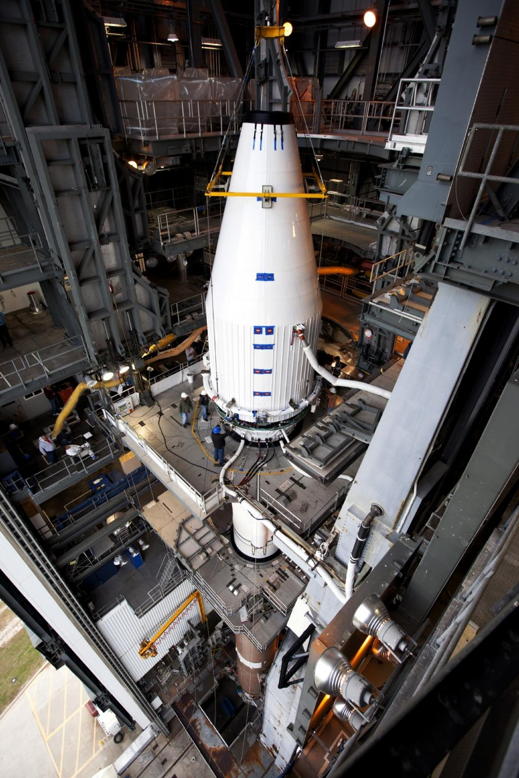 Crews guide NASA's Mars Atmosphere and Volatile EvolutioN, or MAVEN, spacecraft, inside a payload fairing, into place atop a United Launch Alliance Atlas V rocket at the Vertical Integration Facility at Space Launch Complex 41.