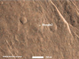 This annotated image from NASA's Mars Reconnaissance Orbiter shows a bright feature interpreted as the United Kingdom's Beagle 2 Lander, which was never heard from after its expected Dec. 25, 2003, landing.