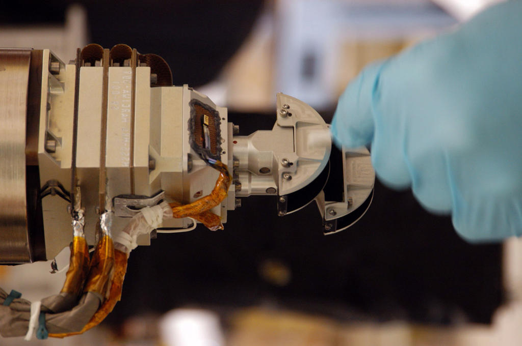 The Mars Color Imager (MARCI), shown here with a gloved hand for scale, is designed to produce a global map to help characterize daily, seasonal and year-to-year variations in Mars' climate, providing a daily weather report for Mars.