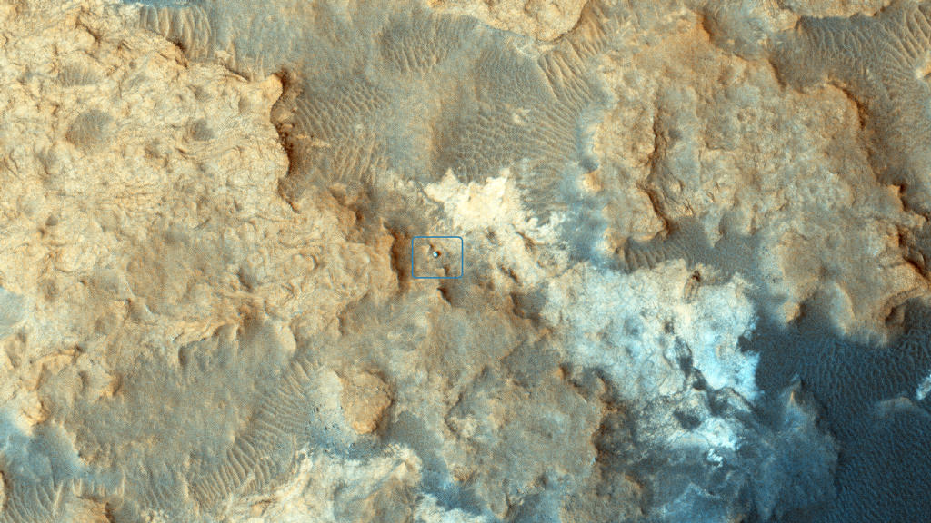"NASA's Curiosity Mars rover can be seen at the ""Pahrump Hills"" area of Gale Crater in this view from the High Resolution Imaging Science Experiment (HiRISE) camera on NASA's Mars Reconnaissance Orbiter."
