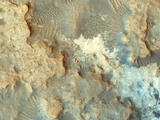 read the article 'Mars Orbiter Spies Curiosity Rover at Work'