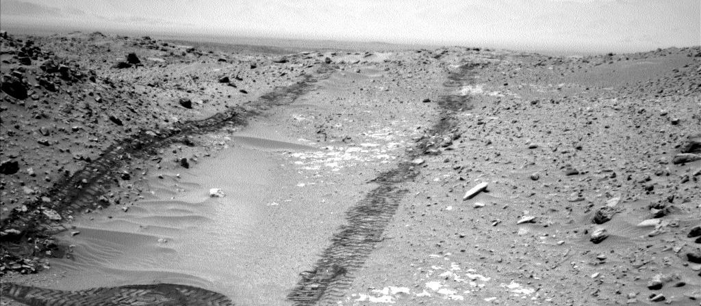 "In this image from NASA's Curiosity Mars rover looking up the ramp at the northeastern end of ""Hidden Valley,"" a pale outcrop including drilling target ""Bonanza King"" is at the center of the scene."
