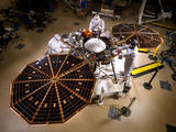 The solar arrays on NASA's InSight lander are deployed in this test inside a clean room at Lockheed Martin Space Systems, Denver.