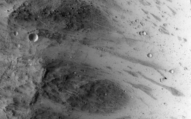 read the article 'Tall Boulder Rolls Down Martian Hill, Lands Upright'