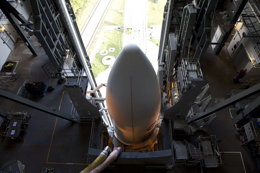 On Cape Canaveral Air Force Station in Florida, the payload fairing protecting NASA's Mars Science Laboratory (MSL) stands atop the 197-foot-tall United Launch Alliance Atlas V rocket, which is ready to roll from the Vertical Integration Facility (VIF) to the launch pad at Space Launch Complex 41.