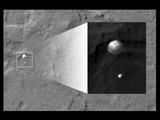 read the article 'NASA's Curiosity Rover Caught in the Act Landing'