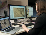Scientist Katie Stack Morgan examines rover images on her computer. Images, even 3-D stereo views, lack a natural sense of depth that human vision employs to understand spatial relationships.