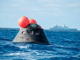 NASA's Orion spacecraft awaits the U.S. Navy's USS Anchorage for a ride home.