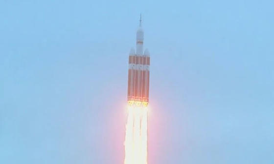 read the article 'Orion Soars on First Flight Test'