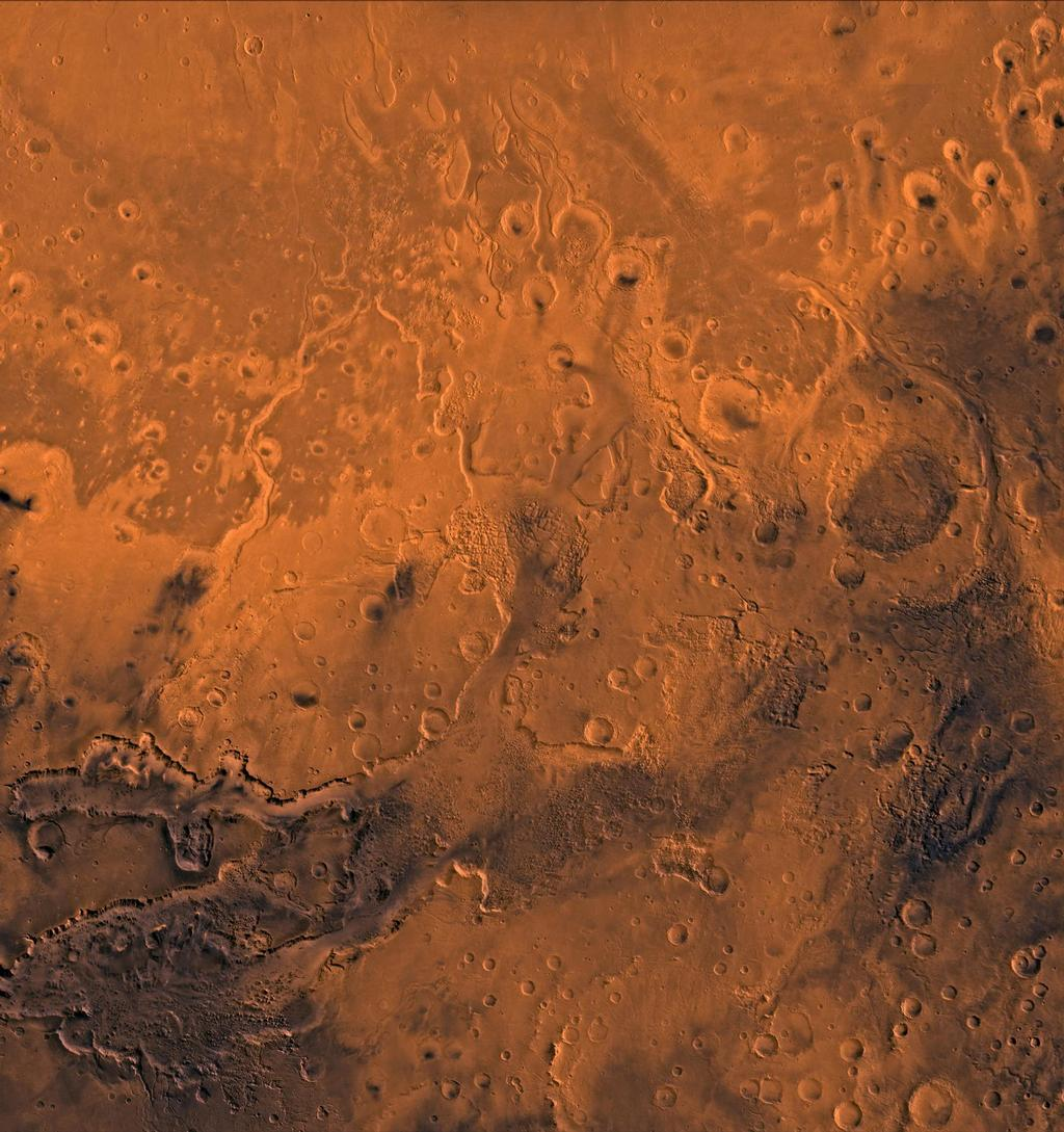 A color image of the south Chryse basin Valles Marineris outflow channels on Mars; north toward top. The scene shows on the southwest corner the chaotic terrain of the east part of Valles Marineris and two of its related canyons: Eos and Capri Chasmata (south to north). Ganges Chasma lies directly north. The chaos in the southern part of the image gives rise to several outflow channels, Shalbatana, Simud, Tiu, and Ares Valles (left to right), that drained north into the Chryse basin. The mouth of Ares Valles is the site of the Mars Pathfinder lander.