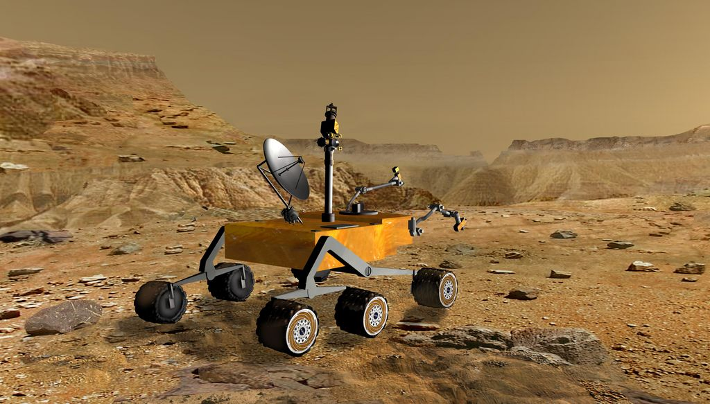 NASA's Mars Science Laboratory travels near a canyon on Mars in this artist's concept. The mission is under development for launch in 2009 and a precision landing on Mars in 2010.
