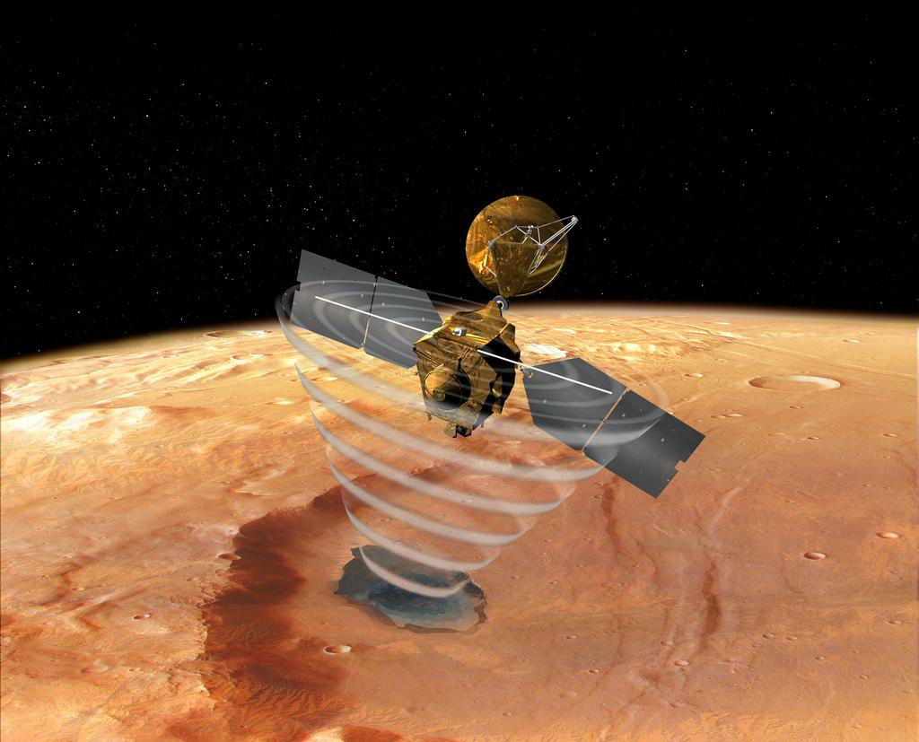 "This image is an artist's concept of a view looking down on NASA's Mars Reconnaissance Orbiter. The spacecraft is pictured using its Shallow Subsurface Radar instrument (SHARAD) to ""look"" under the surface of Mars."