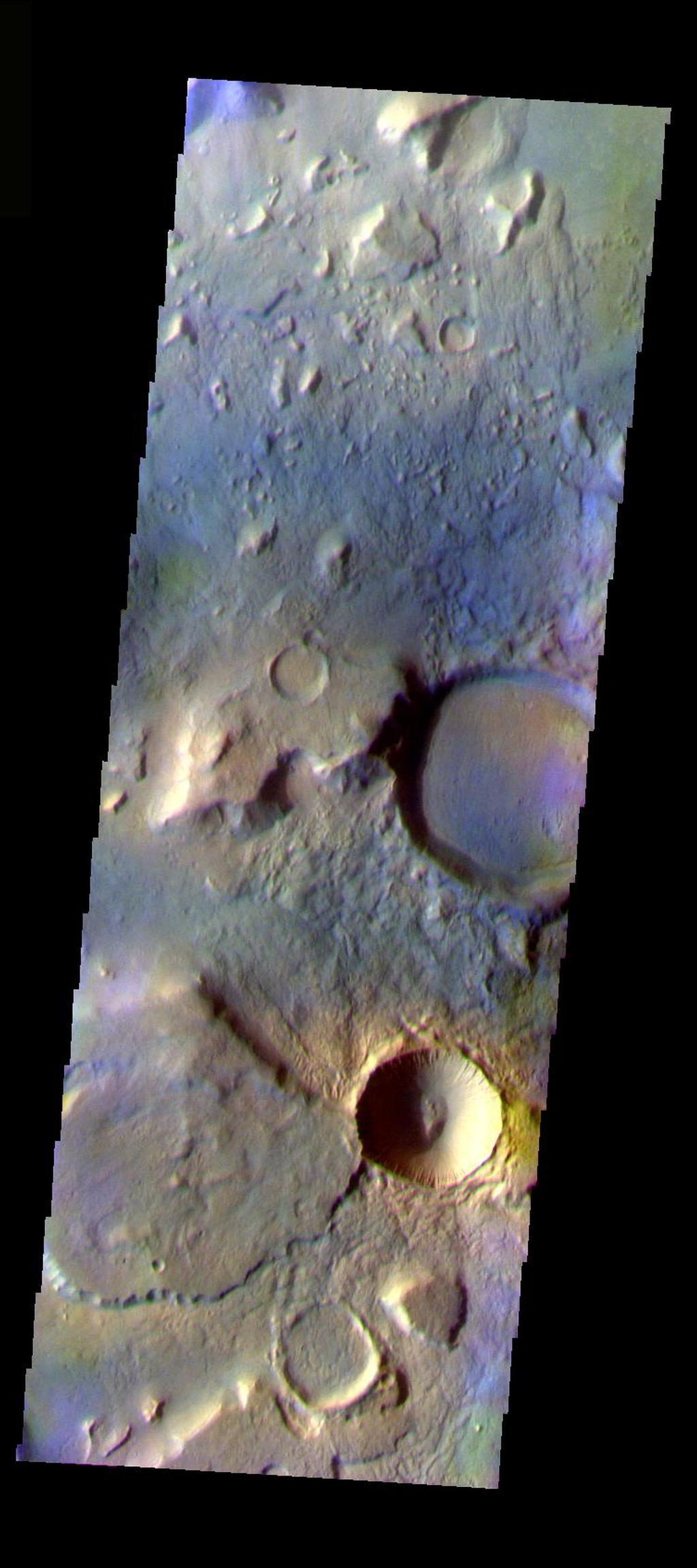 This false color image shows a region with craters of different ages located at the margin of Acidalia Planitia. This image was collected during the Northern Spring season. The THEMIS VIS camera is capable of capturing color images of the Martian surface using five different color filters. In this mode of operation, the spatial resolution and coverage of the image must be reduced to accommodate the additional data volume produced from using multiple filters. To make a color image, three of the five filter images (each in grayscale) are selected. Each is contrast enhanced and then converted to a red, green, or blue intensity image. These three images are then combined to produce a full color, single image. Because the THEMIS color filters don't span the full range of colors seen by the human eye, a color THEMIS image does not represent true color. Also, because each single-filter image is contrast enhanced before inclusion in the three-color image, the apparent color variation of the scene is exaggerated. Nevertheless, the color variation that does appear is representative of some change in color, however subtle, in the actual scene. Note that the long edges of THEMIS color images typically contain color artifacts that do not represent surface variation.