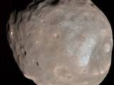 read the article 'NASA Spacecraft Images Mars Moon in Color and in 3D'