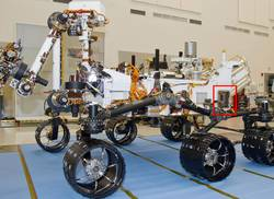 A Russian-built, neutron-shooting instrument on the Curiosity rover of NASA's Mars Science Laboratory mission will check for water-bearing minerals in the ground beneath the rover.