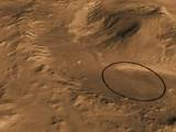 This computer-generated view based on multiple orbital observations shows Mars' Gale crater as if seen from an aircraft northwest of the crater.
