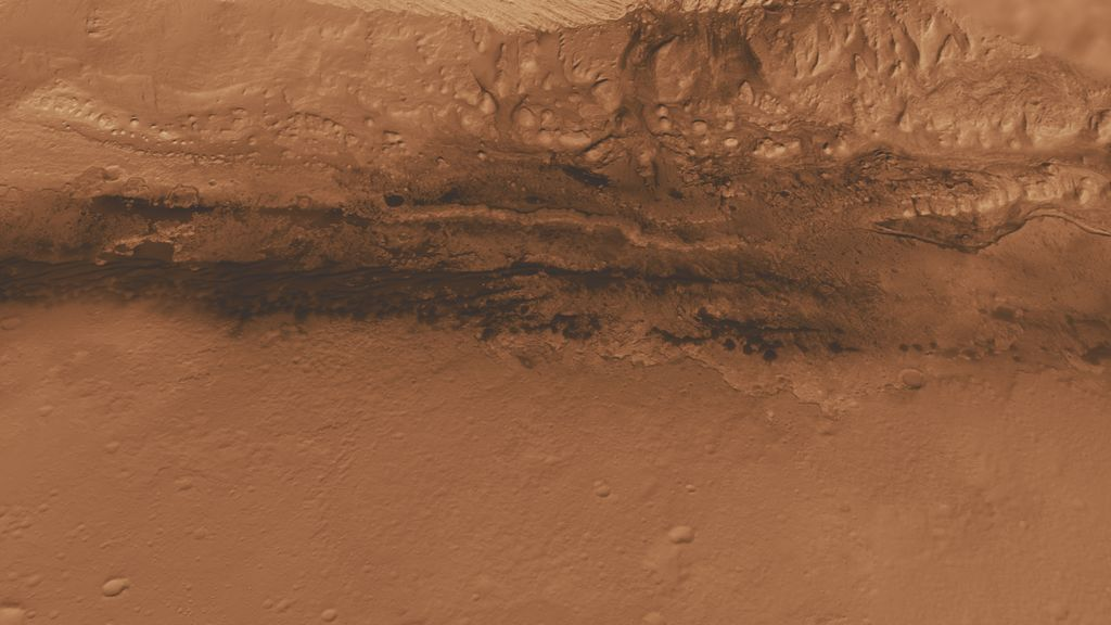 This oblique view of the lower mound in Gale crater on Mars shows an area of top scientific interest for the Mars Science Laboratory mission.