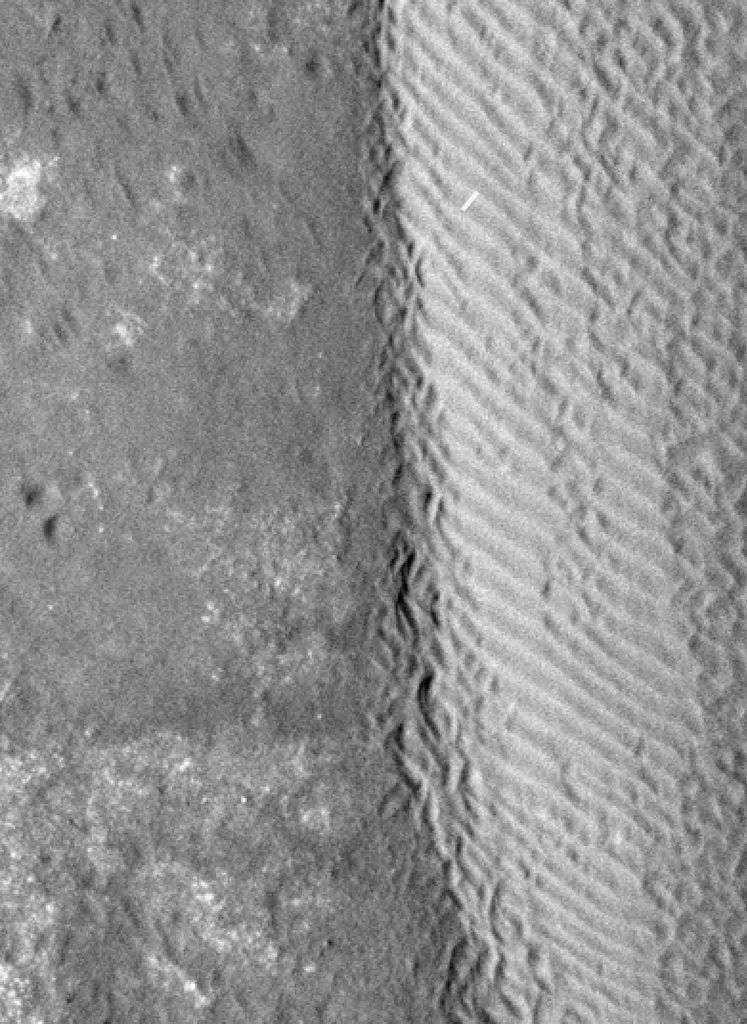 The eastern margin of a rippled dune in Herschel Crater on Mars moved an average distance of three meters (about three yards) between March 3, 2007 and December 1, 2010, as seen by NASA's Mars Reconnaissance Orbiter.