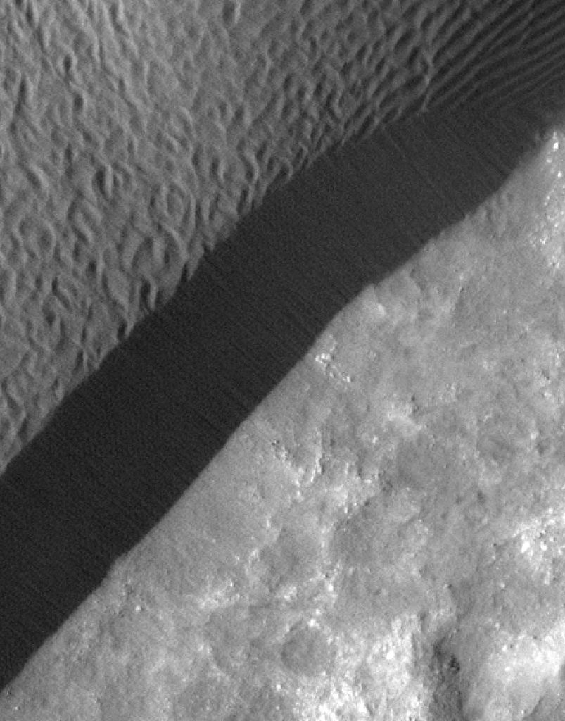 A rippled dune front in Herschel Crater on Mars moved an average of about one meter (about one yard) between March 3, 2007 and December 1, 2010, as seen in these images from NASA's Mars Reconnaissance Orbiter.