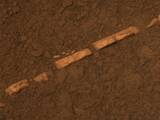 read the article 'NASA Mars Rover Finds Mineral Vein Deposited By Water'
