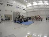 NASA's Curiosity rover and its powered descent vehicle pose for photographs prior to being integrated for launch at JPL's Spacecraft Assembly Facility.