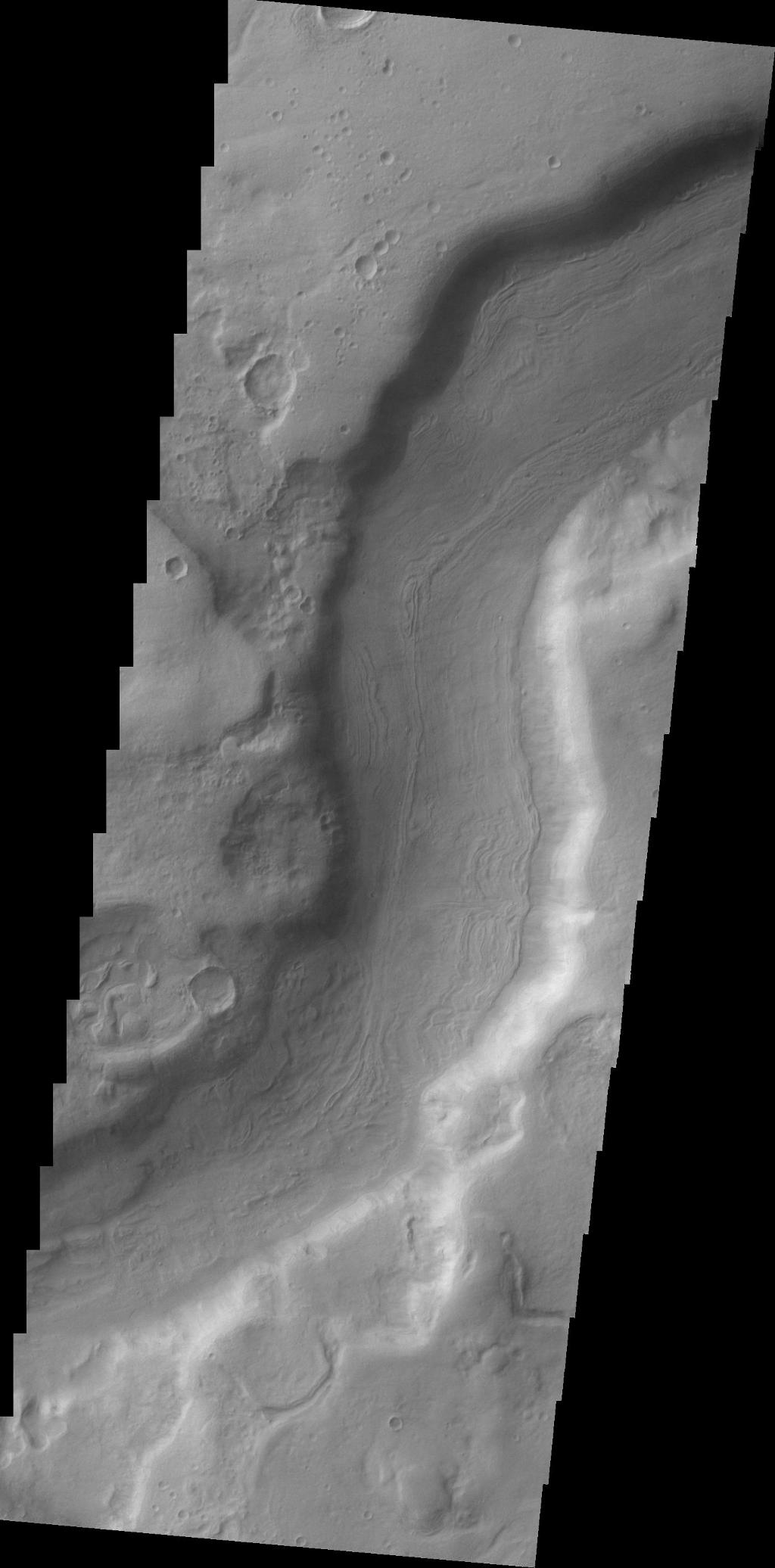 A small section of Dao Vallis in shown in this VIS image. Dao Vallis is a major channel that drains into Hellas Planitia