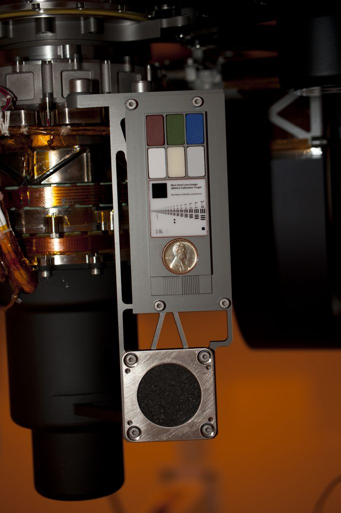 Two instruments at the end of the robotic arm on NASA's Mars rover Curiosity will use calibration targets attached to a shoulder joint of the arm.