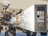 read the article 'Mars-Bound NASA Rover Carries Coin For Camera Checkup'