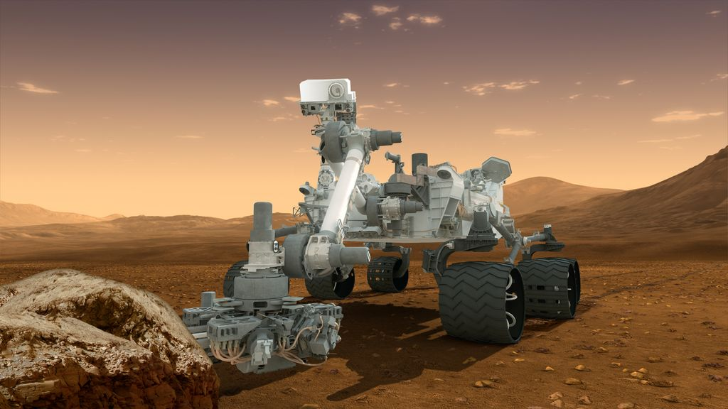 In this picture, the rover examines a rock on Mars with a set of tools at the end of the rover's arm, which extends about 7 feet (2 meters).