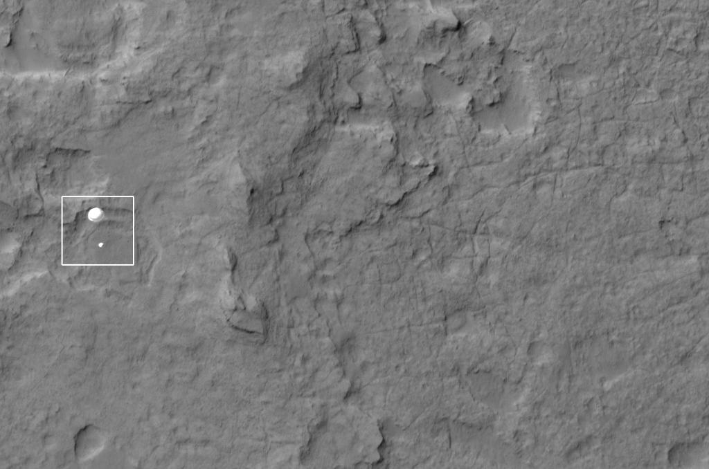 NASA's Curiosity rover and its parachute were spotted by NASA's Mars Reconnaissance Orbiter as Curiosity descended to the surface on Aug. 5 PDT (Aug. 6 EDT).