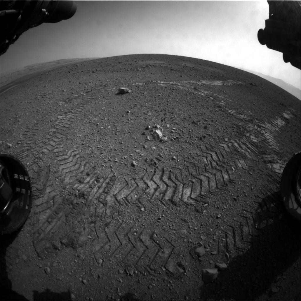 This image shows the tracks left by NASA's Curiosity rover on Aug. 22, 2012, as it completed its first test drive on Mars.