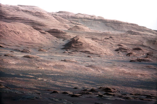 A chapter of the layered geological history of Mars is laid bare in this postcard from NASA's Curiosity rover. The image shows the base of Mount Sharp, the rover's eventual science destination.