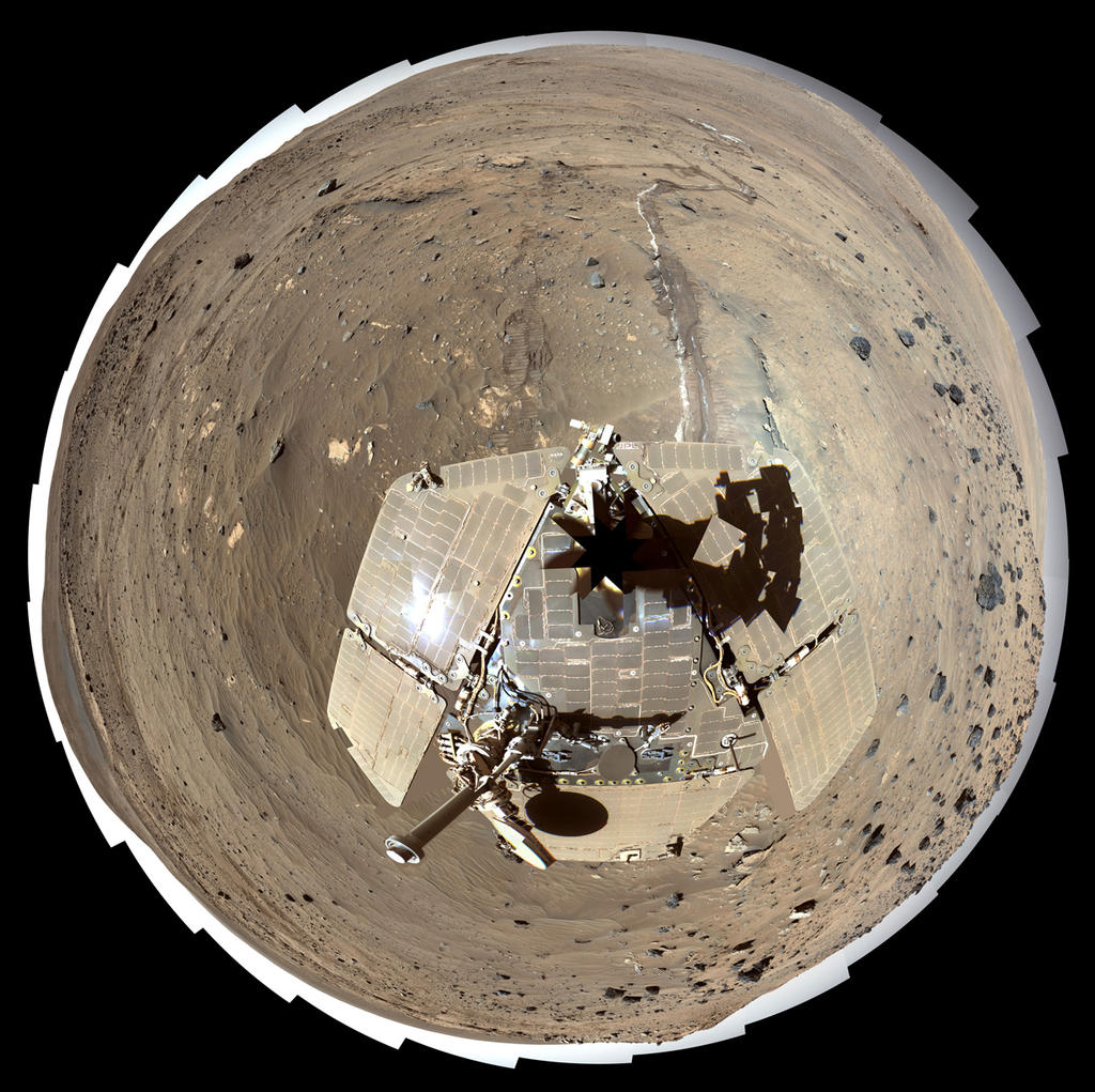 "This self-portrait of NASA's Mars Exploration Rover Spirit is a polar projection of the 360-degree ""McMurdo"" panorama made from images taken by Spirit's panoramic camera (Pancam)."