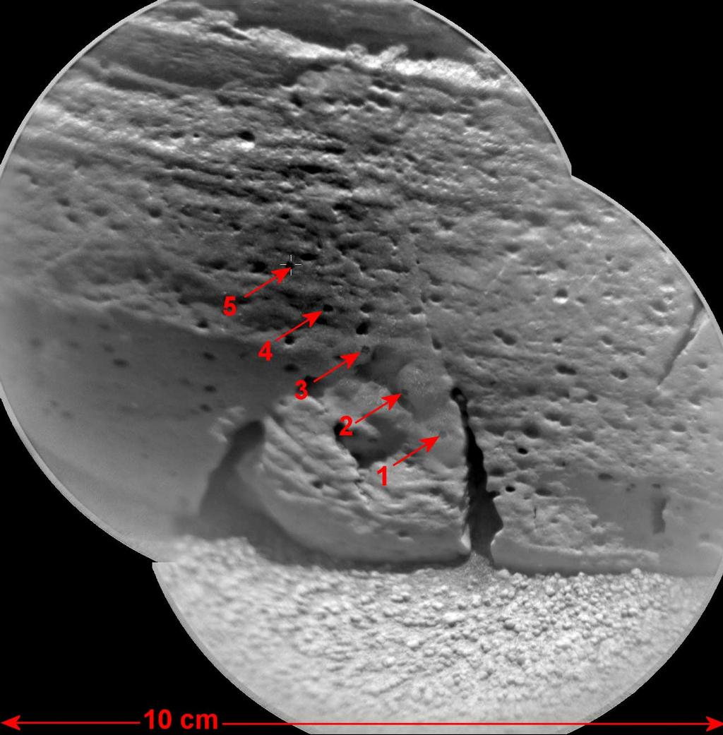 "This view of a rock called ""Rocknest 3"" combines two images taken by the Chemistry and Camera (ChemCam) instrument on the NASA Mars rover Curiosity and indicates five spots where ChemCam had hit the rock with laser pulses to check its composition."