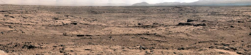 "This panorama is a mosaic of images taken by the Mast Camera (Mastcam) on the NASA Mars rover Curiosity while the rover was working at a site called ""Rocknest"" in October and November 2012."