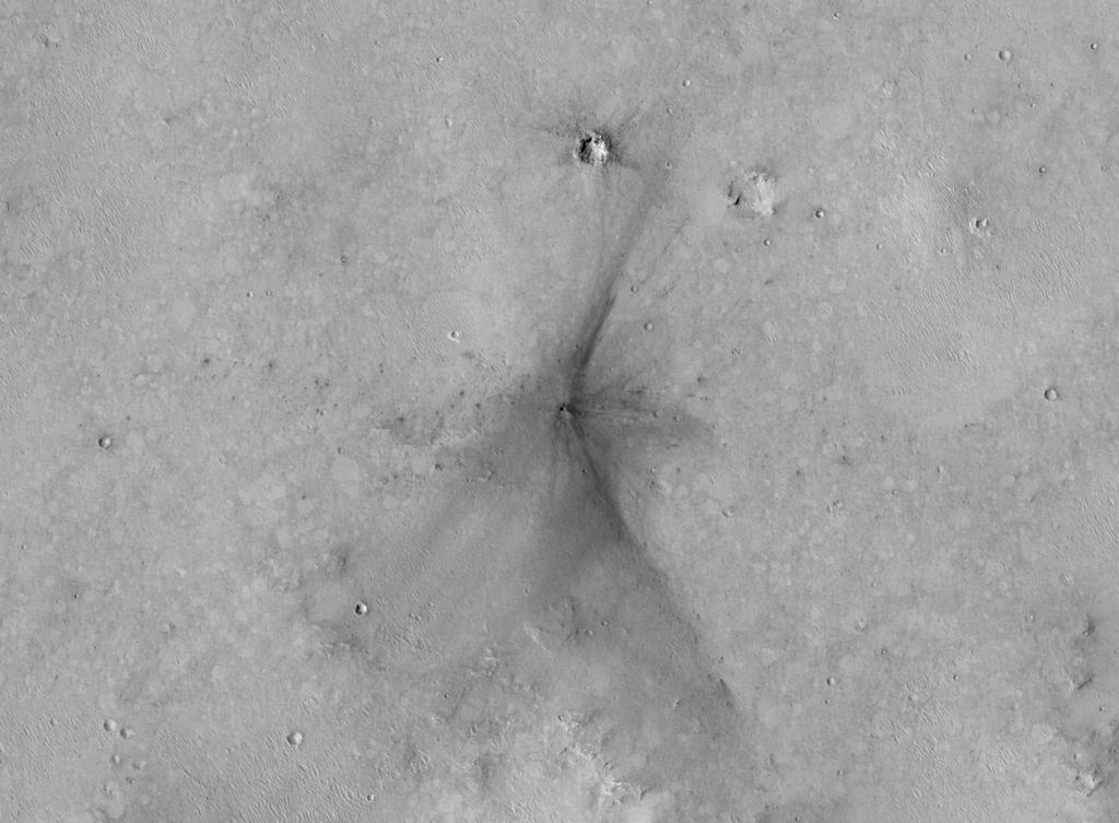 This image from the NASA Mars Reconnaissance Orbiter shows an impact scar on Mars made by pieces of the NASA Mars Science Laboratory spacecraft that the spacecraft shed just before entering the Martian atmosphere.