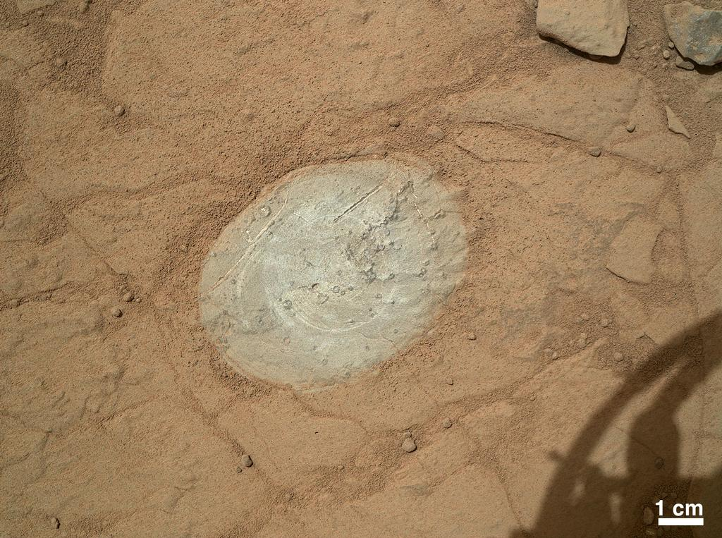 This image from the Mars Hand Lens Imager (MAHLI) on NASA's Mars rover Curiosity shows the patch of rock cleaned by the first use of the rover's Dust Removal Tool (DRT).