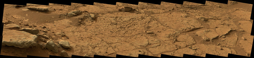 This wide view of the 'John Klein' location selected for the first rock drilling by NASA's Mars rover Curiosity is a mosaic taken by Curiosity's right Mast Camera (Mastcam) during the afternoon of the 153rd Martian day, or sol, of the rover's work on Mars.