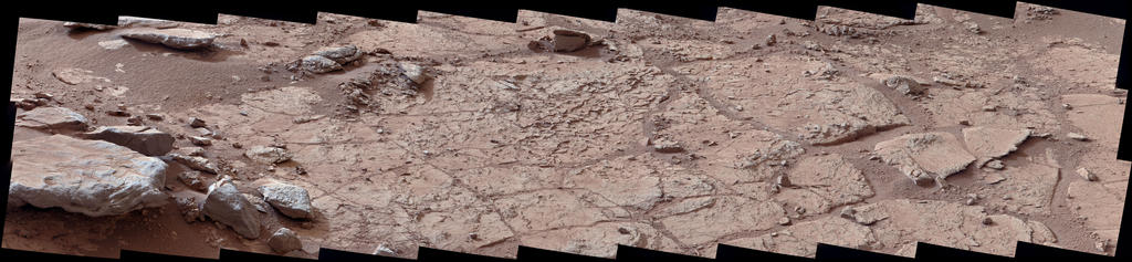 "This wide view of the ""John Klein"" location selected for the first rock drilling by NASA's Mars rover Curiosity is a mosaic taken by Curiosity's right Mast Camera (Mastcam) during the afternoon of the 153rd Martian day, or sol, of the rover's work on Mars."