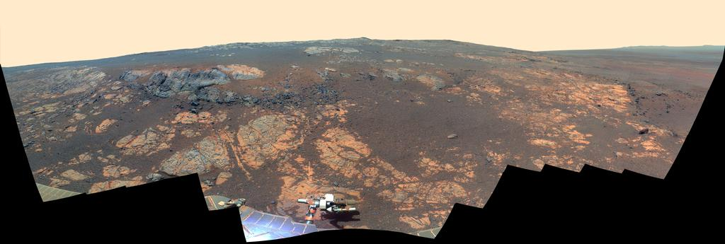 As NASA's Mars Exploration Rover Opportunity neared the ninth anniversary of its landing on Mars, the rover was working in the 'Matijevic Hill' area seen in this view from Opportunity's panoramic camera (Pancam).