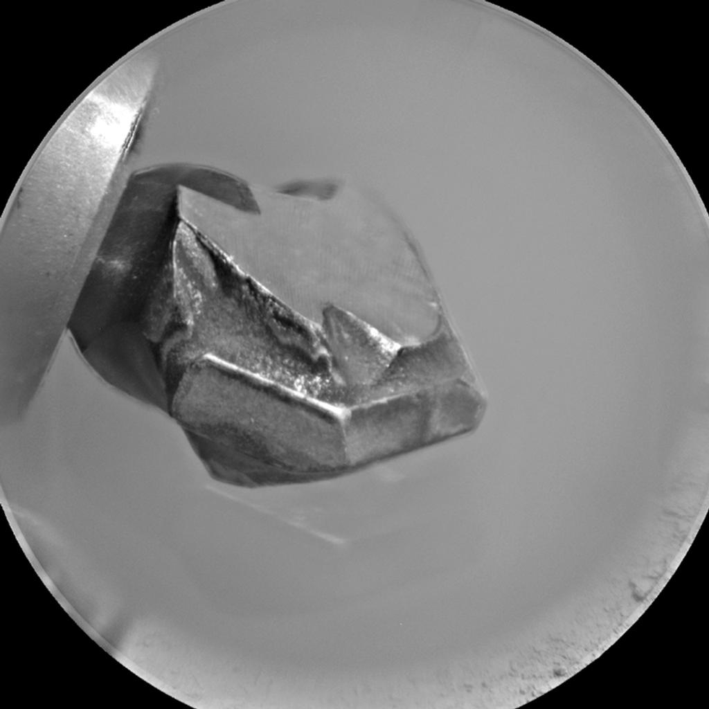 The shape of the tip of the bit in the drill of NASA's Mars rover Curiosity is apparent in this view recorded by the remote micro-imager in the rover's Chemistry and Camera instrument during the 172nd Martian day, or sol, of Curiosity's work on Mars (Jan. 29, 2012).