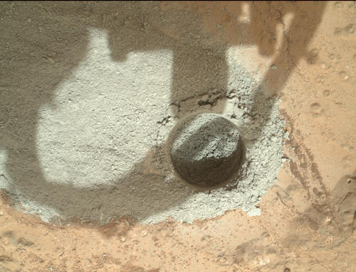 "In an activity called the ""mini drill test,"" NASA's Mars rover Curiosity used its drill to generate this ring of powdered rock for inspection in advance of the rover's first full drilling."