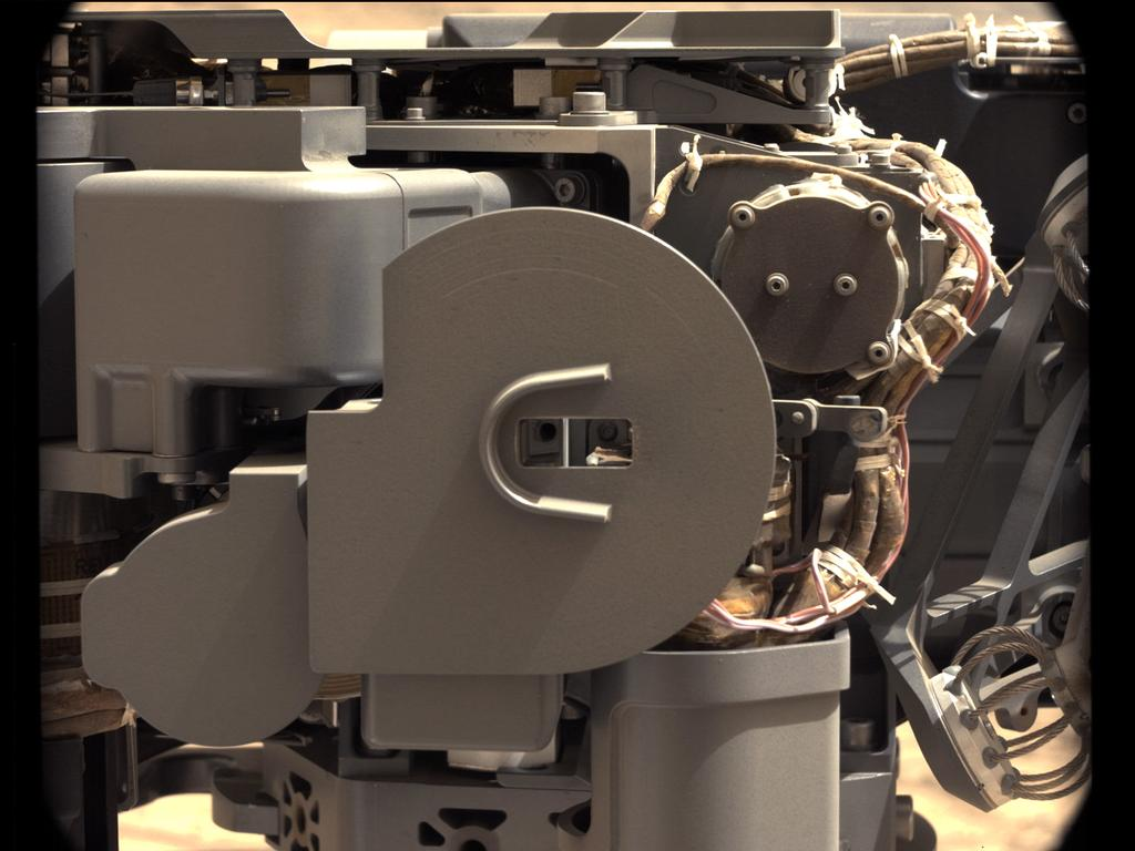 The left Mast Camera (Mastcam) on NASA's Mars rover Curiosity took this image of Curiosity's sample-processing and delivery tool just after the tool delivered a portion of powdered rock into the rover's Sample Analysis at Mars (SAM) instrument.