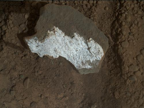 "This close-up view of ""Tintina"" was taken by the rover's Mars Hand Lens Imager (MAHLI) on Sol 160 (Jan. 17, 2013) and shows interesting linear textures in the bright white material on the rock."