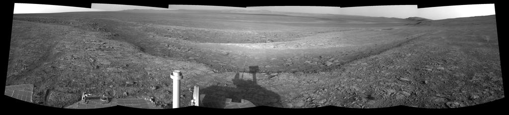 This left-eye member of a stereo pair of images from the navigation camera on NASA's Mars Exploration Rover Opportunity shows a vista across Endeavour Crater, with the rover's own shadow in the foreground.